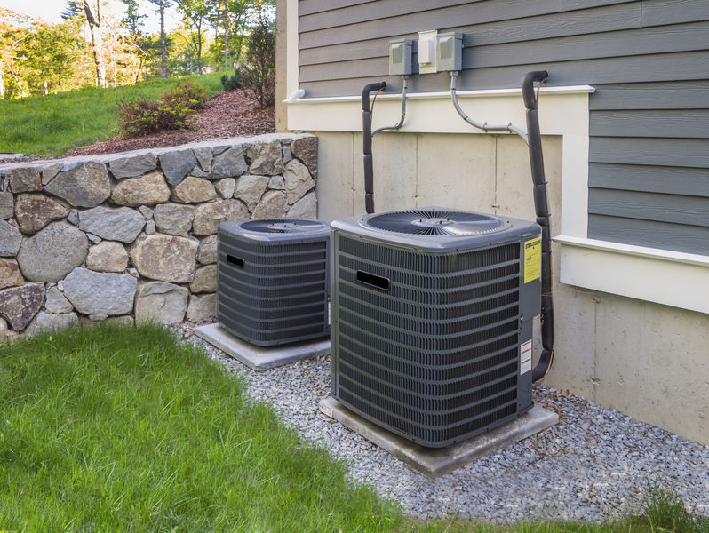 outdoor HVAC units in yard